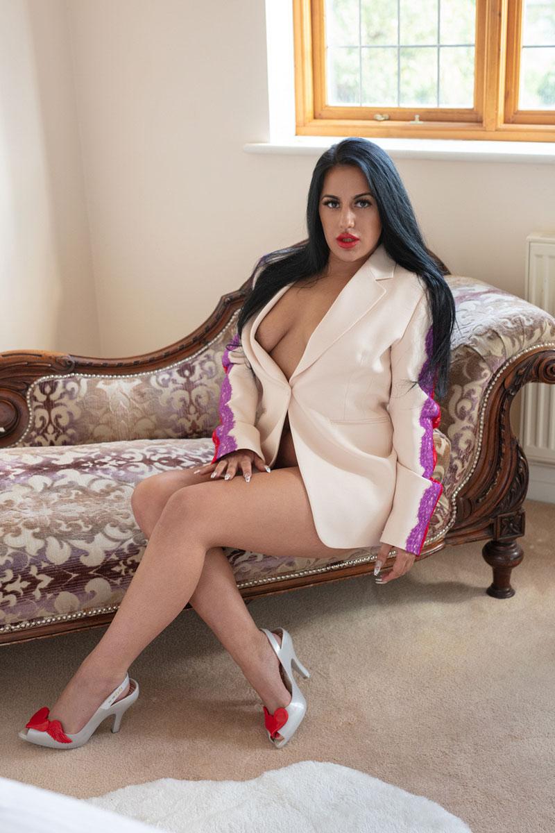 Seductive exotic woman sat on chair